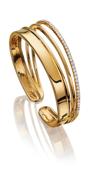 This Ortaea Armor bangle is set in 18K yellow gold with 1.29 carats of white diamonds and retails at Harvey Nichols for £8,590 ($11,437)