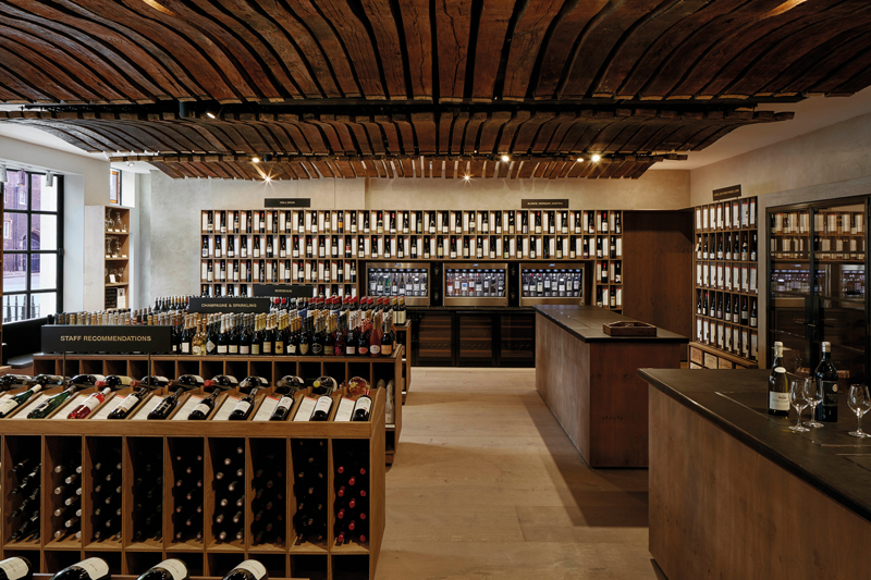 The new shop features staves from 100-year-old French wine barrels, which line the ceiling - Ph: Berry Bros & Rudd