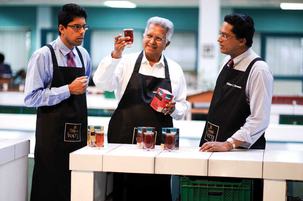 Merrill J Fernando has imparted his knowledge and passion for tea to his sons Malik J Fernando (left) and Dilhan C Fernando