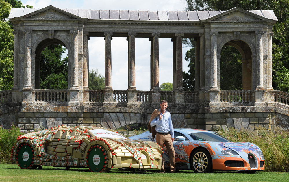 Lord Pembroke, co-founder of the Wilton Classic and Supercars (WCS), stands alongside his Bugatti Veyron and a one-off, life-sized replica of this car made from over 400 Castrol EDGE bottles and barrels, at Wilton House in Salisbury, UK - Ph. Press Association