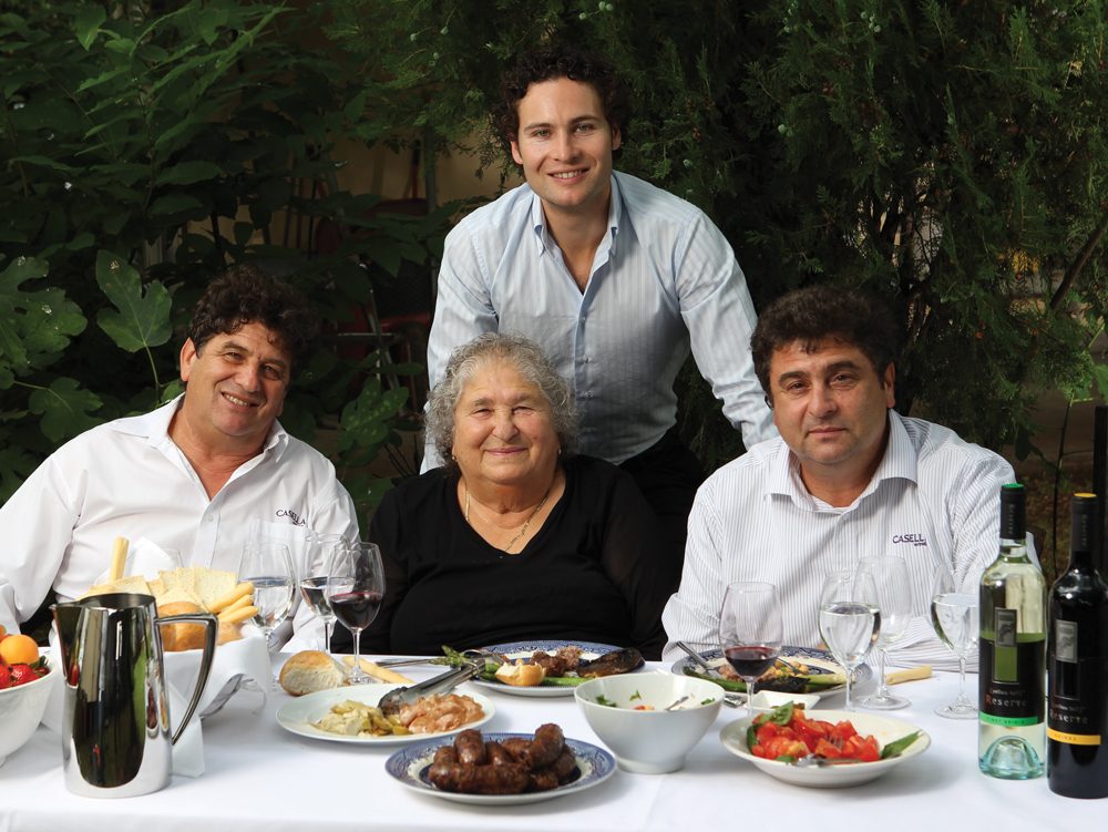 Three generations of the Casella family have helped build Casella Wines from a small regional winery to Australia's top wine exporter to the US (from left) Joe, co-founder Maria (who sadly passed away in August last year), Daniel (centre), and John