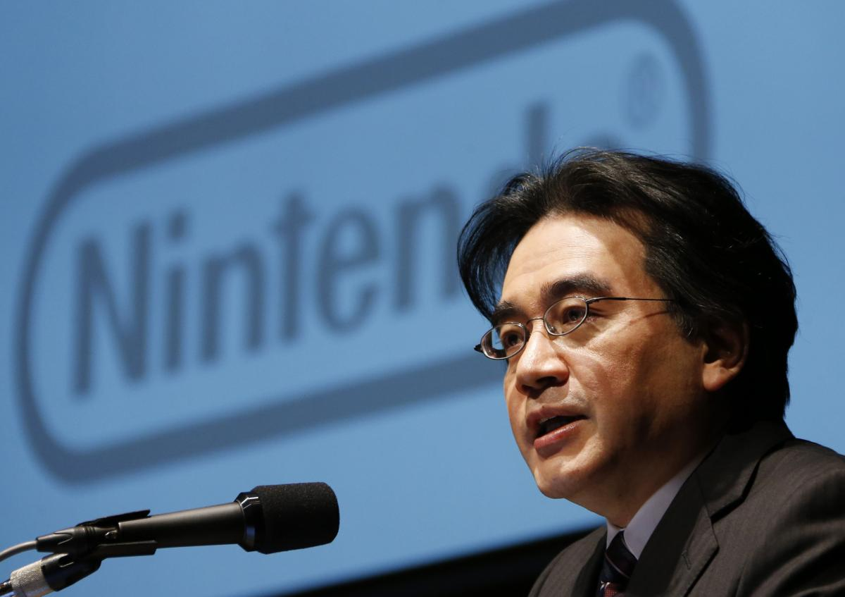 Former Nintendo president Satoru Iwata speaks during a news conference in Tokyo. The videogame designer and businessman died in 2015 of a bile duct tumour