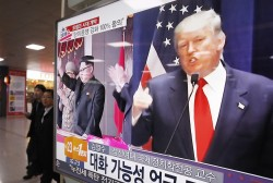 A TV screen shows pictures of U.S. President-elect Donald Trump, right, and North Korean leader Kim Jong Un, at the Seoul Railway Station in Seoul, South Korea.