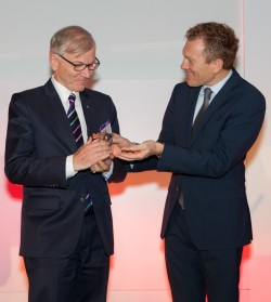 Stefan Messer (left), of Germany's Messer Group, accepts the Top Sustainable Family Business Award 2016 from Société Générale Group Head Jean-François Mazaud.