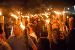 Far-right protestors demonstrate in Charlottesville, Virginia, carrying Tiki torches.