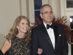 Comcast's Brian Roberts (right) and wife Aileen