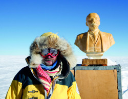 Henry Cookson, explorer and founder of Cookson Adventures, next to the statue of Lenin at the Pole of Inaccessibility, the Antarctic's most remote spot, during his recordbreaking trek in 2007