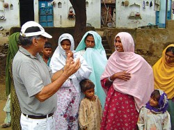 Dr Suri Sehgal with women from one of the villages helped by IRRAD