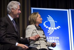 Bill and Hillary clinton on stage at the Clinton Global Initiative America