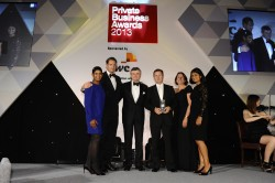 Steve Rigby, fourth from left, accepted the award on behalf on the fambiz