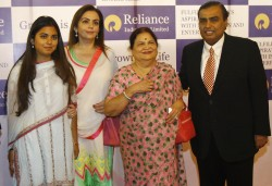 Isha Ambani, with her mother, grandmother, and father