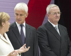 Martin Winterkorn (right) at last week's Frankfurt Auto Show. He stands beside Matthias Mueller, his rumoured replacement, and German chancellor Angela Merkel
