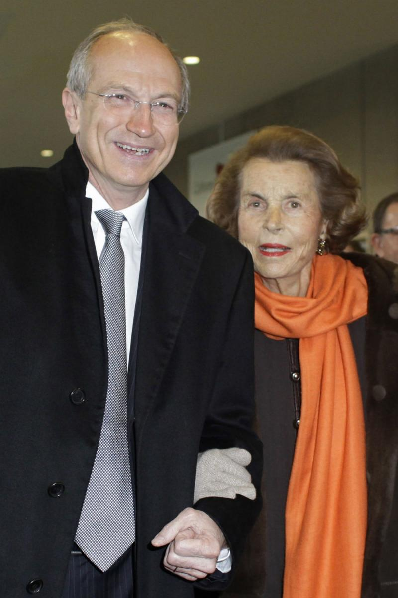 L'Oreal heiress Liliane Bettencourt, right, and L'Oreal chief executive Jean-Paul Agon